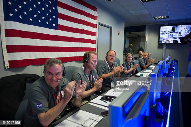 In this NASA handout From left to right Michael Watkins director NASA's Jet Propulsion Laboratory Rick Nybakken Juno project manager Jet Propulsion...