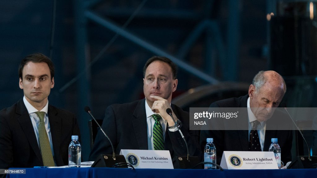 In this NASA handout image, acting NASA Administrator Robert Lightfoot, center, along with Deputy Chief Technology Officer of the United States Michael Kratsios, left, and Director of National Intelligence Daniel Coats, right, listen to remarks by panelists during the National Space Council's first meeting at the Smithsonian National Air and Space Museum's Steven F. Udvar-Hazy Center on October 5, 2017 in Chantilly, Virginia. The National Space Council, chaired by Vice President Pence, heard testimony from representatives from civil space, commercial space, and national security space industry representatives.
