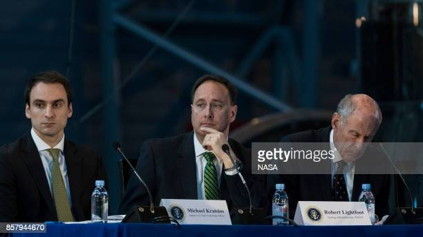 In this NASA handout image acting NASA Administrator Robert Lightfoot center along with Deputy Chief Technology Officer of the United States Michael...