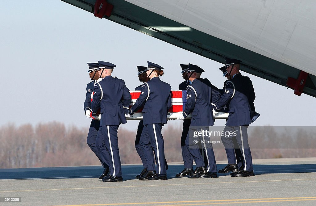 In this NASA handout image, an Air Force honor guard carries a casket containing the remains of an astronaut from the Space Shuttle Columbia on February 5, 2003 at Dover Air Force Base, Delaware. NASA Mission Control lost contact with the Space Shuttle Columbia during reentry on February 1, 2003 and later learned that the shuttle had broken up over Texas. Debris from the wreckage drifted hundreds of miles from central Texas to eastern Louisiana. The bodies of the crew of the Space Shuttle Columbia were recovered from the crash area in Texas.
