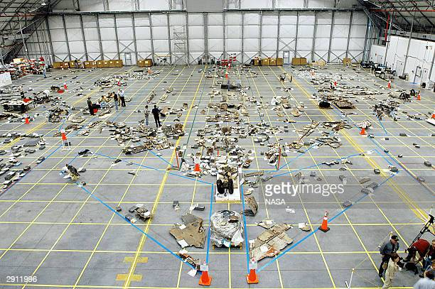 In this NASA handout image debris from the Space Shuttle Columbia is placed on a grid March 27 2003 at Kennedy Space Center Florida The oneyear...