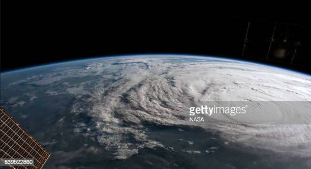 In this NASA handout image Hurricane Harvey is photographed aboard the International Space Station as it intensified on its way toward the Texas...