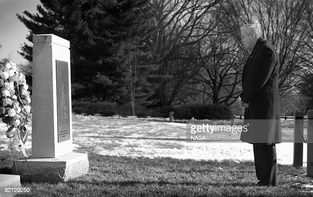 In this NASA handout NASA Administrator Sean O'Keefe visits Arlington National Cemetary to lay a wreath honoring the crew of the Space Shuttle...