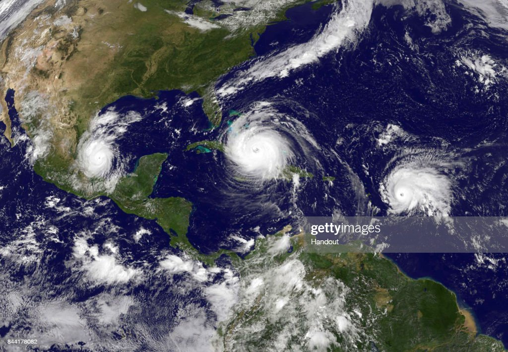 In this NASA/NOAA handout image, NOAA's GOES satellite shows Hurricane Irma (C) in the Caribbean Sea, Tropical Storm Jose (R) in the Atlantic Ocean and Tropical Storm Katia in the Gulf of Mexico taken at 15:45 UTC on September 08, 2017. Hurricane Irma barreled through the Turks and Caicos Islands as a category 4 storm en route to a destructive encounter with Florida this weekend.