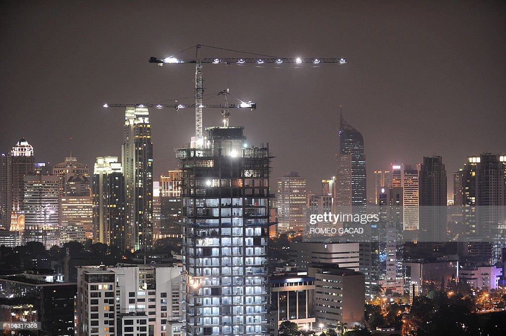 In this night skyline picture taken on November 12, 2012, a high rise building construction is pictured in full swing in the capital city of Jakarta. Strong investment and domestic spending have seen Indonesia remain one of the best performers in Asia. Southeast Asia's biggest economy on November 12, 2012 announced growth of 6.2 percent in the third quarter from a year earlier. AFP PHOTO / ROMEO GACAD