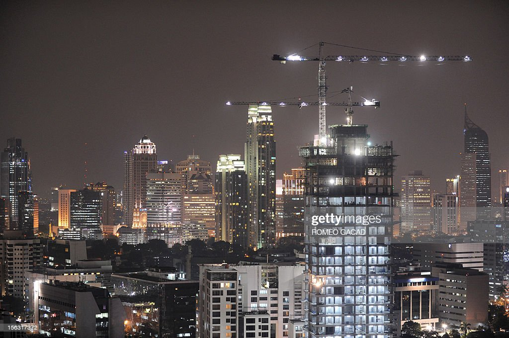 In this night skyline picture taken on November 12, 2012, a high rise building construction is pictured in full swing in the capital city of Jakarta. Strong investment and domestic spending have seen Indonesia remain one of the best performers in Asia. Southeast Asia's biggest economy on November 12, 2012 announced growth of 6.2 percent in the third quarter from a year earlier.