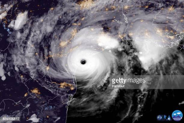 In this NOAA handout image NOAA's GOES East satellite capture of Hurricane Harvey shows the storm making landfall shortly after 800pm CDT on August...