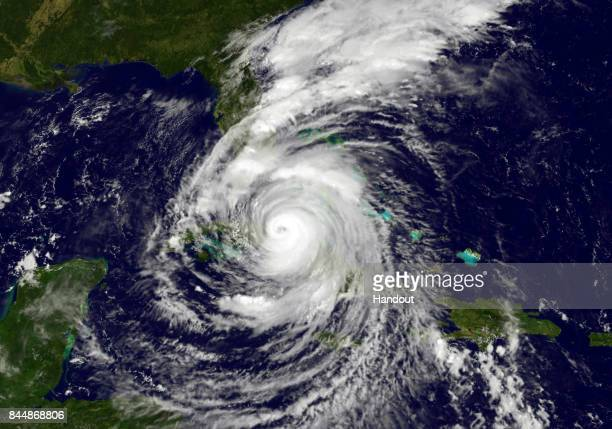 In this NOAANASA GOES Project handout image GOES satellite shows Hurricane Irma as it moves over Cuba and towards the Florida coast as a category 4...