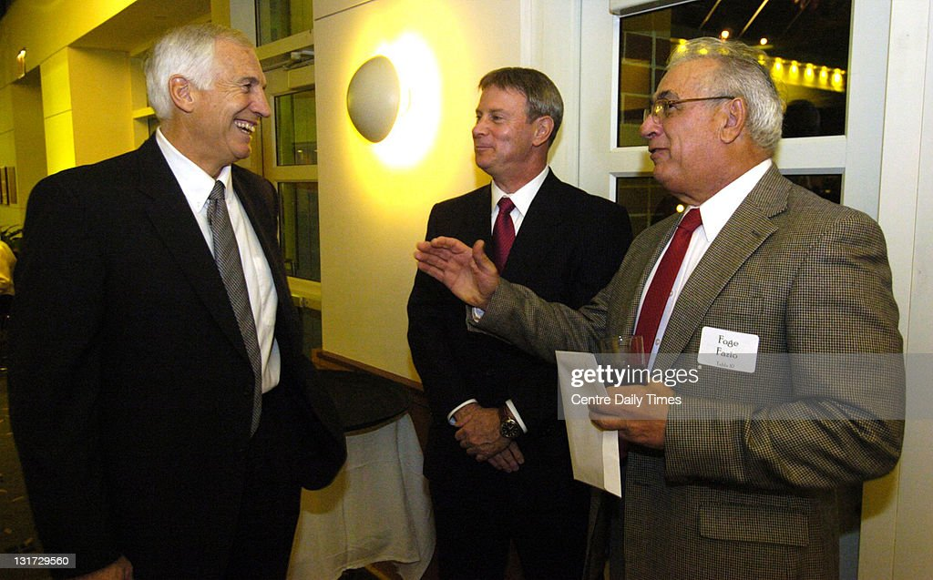 In this Nov. 19, 2004 file photograph, Second Mile founder and former Penn State defensive coordinator Jerry Sandusky, from left, Steve Bogner and former Pittsburgh football head coach Foge Fazio exchange football stories before The Second Mile Mercedes Benz Reverse Drawing Dinner at Penn State. On November 5, 2011, Sandusky was arrested on charges that he preyed on boys he met through The Second Mile, a charity he founded for at-risk youths. He faces charges including seven counts of first-degree involuntary deviate sexual intercourse, all of which are punishable by up to 20 years in prison and a $25,000 fine.