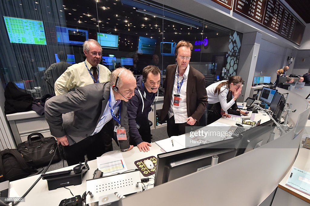 In this November 12 2014 handout photo provided by the European Space Agency The Rosetta mission crew monitors Philae successfully landing on comet...