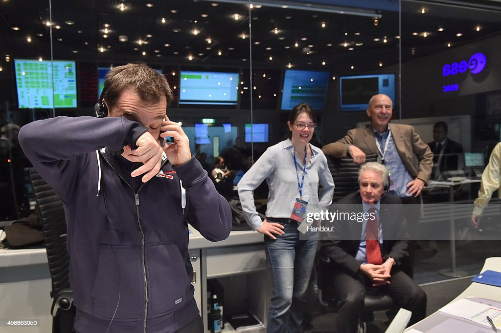 In this November 12 2014 handout photo provided by the European Space Agency The Rosetta mission crew celebrates Philae successfully landing on comet...