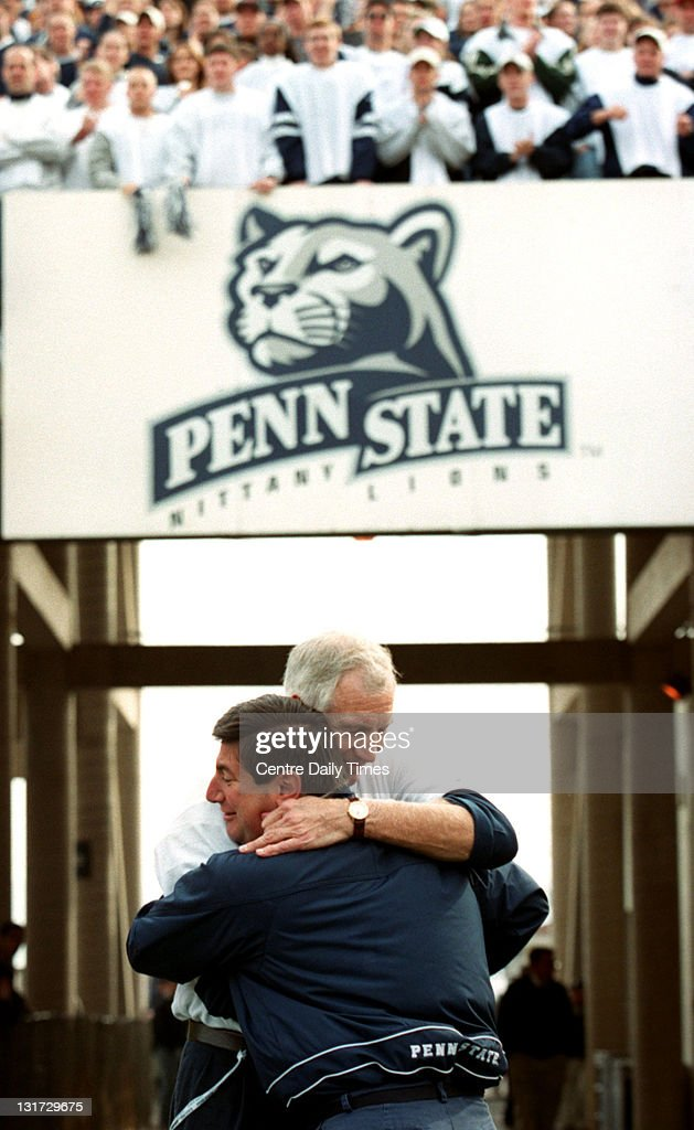 In this November 13, 1999 file photograph, former Penn State defensive coordinator Jerry Sandusky, facing camera, is hugged by Tommy Venturino before being introduced to the crowd. On November 5, 2011, Sandusky was arrested on charges that he preyed on boys he met through The Second Mile, a charity he founded for at-risk youths. He faces charges including seven counts of first-degree involuntary deviate sexual intercourse, all of which are punishable by up to 20 years in prison and a $25,000 fine.