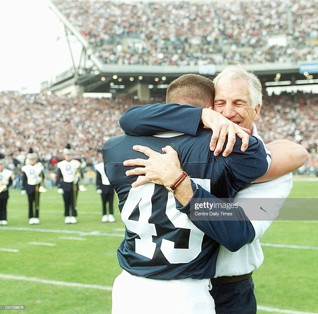 In this November 13, 1999 file photograph, Jon Sandusky (45) hugs his dad defensive coordinator Jerry Sandusky after both were introduced before the game. On November 5, 2011, former Penn State defensive coordinator Sandusky was arrested on charges that he preyed on boys he met through The Second Mile, a charity he founded for at-risk youths. He faces charges including seven counts of first-degree involuntary deviate sexual intercourse, all of which are punishable by up to 20 years in prison and a $25,000 fine.