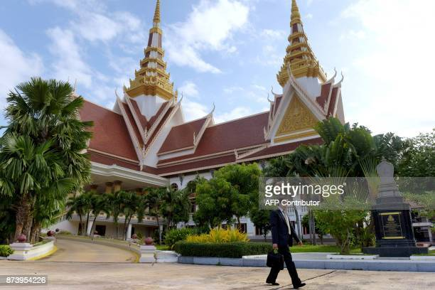 In this November 8 2017 photograph Lim Kimya a member of the National Assembly from Cambodia National Rescue Party walks out of the National Assembly...