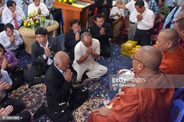 In this October 23 2017 photograph Lim Kimya a member of the National Assembly from Cambodia National Rescue Party prays to Buddhist monks during a...