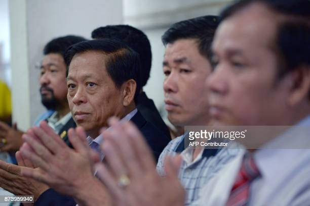 In this October 23 2017 photograph Lim Kimya a member of the National Assembly from Cambodia National Rescue Party applauds with other colleagues...