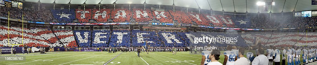 In this panoramic composite taken of fans holding up cards to salute veterans during the national anthem prior to an NFL game against the Detroit Lions at Mall of America Field at the Hubert H. Humphrey Metrodome on November 11, 2012 in Minneapolis, Minnesota.