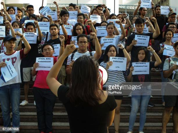 In this photo dated April 19 student activists stage a protest against the planned conferment of an honorary degree to President Rodrigo Duterte by...