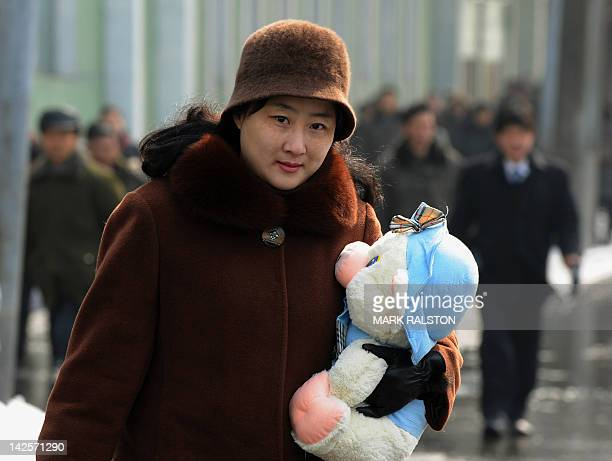 In this photo dated on February 26 A North Korean woman carries a stuffed toy on the streets of the North Korea capital Pyongyang AFP PHOTO/Mark...