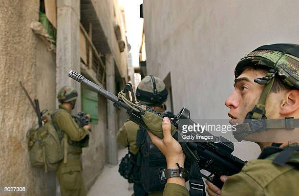 In this photo distributed by the Israeli Defense Forces Israeli soldiers search for wanted Palestinian militants May 24 2003 in the West Bank...