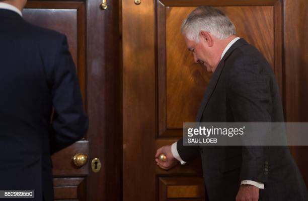 In this photo from November 29 US Secretary of State Rex Tillerson leaves for meetings with Macedonian Foreign Minister Nikola Dimitrov after posing...