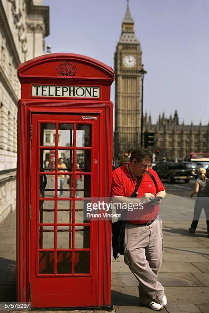 In this photo illlustration a man uses his Personal Digital Assistant to make a telephone call through Voice Over Internet Protocol on May 10 2006 in...