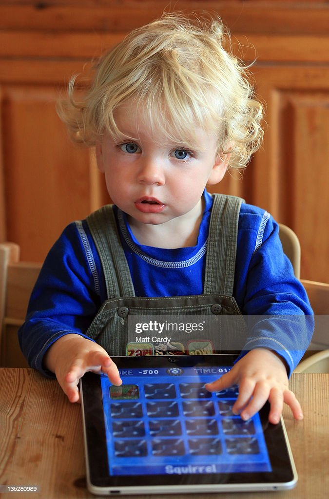 In this photo illustration 13-month old Zac Cardy uses a iPad at his home on November 25, 2011 in Glastonbury, United Kingdom. Tablet computers have become the most wanted Christmas present for children between the ages of 6-11 years. Many parents are having to share their tablet computers with their children as software companies release hundredes of educational and fun applications each month.