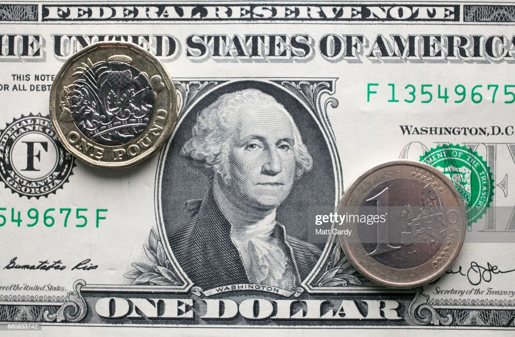 In this photo illustration, a £1 coin is seen a US dollar bill and 1 euro coin on October 13, 2017 in Bath, England. Currency experts have warned that as the uncertainty surrounding Brexit continues, the value of the British pound, which has remained depressed against the US dollar and the euro since the UK voted to leave in the EU referendum, is likely to fluctuate.