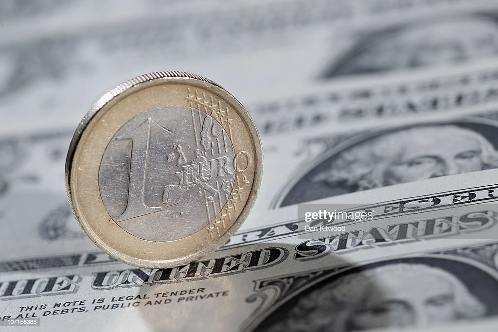 In this photo illustration a 1 Euro coin on a display of one Dollar notes on November 26 2010 in London England Concerns over the Euro zone debts...