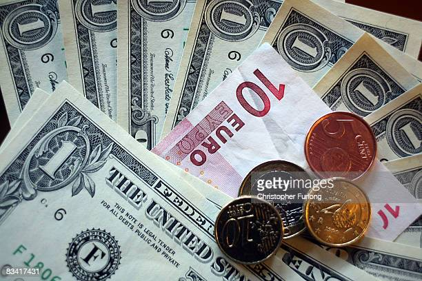 In this photo illustration a 10 Euro note and an assortment of Euro cent coins lie next to USD notes on October 23 2008 in Manchester England As...