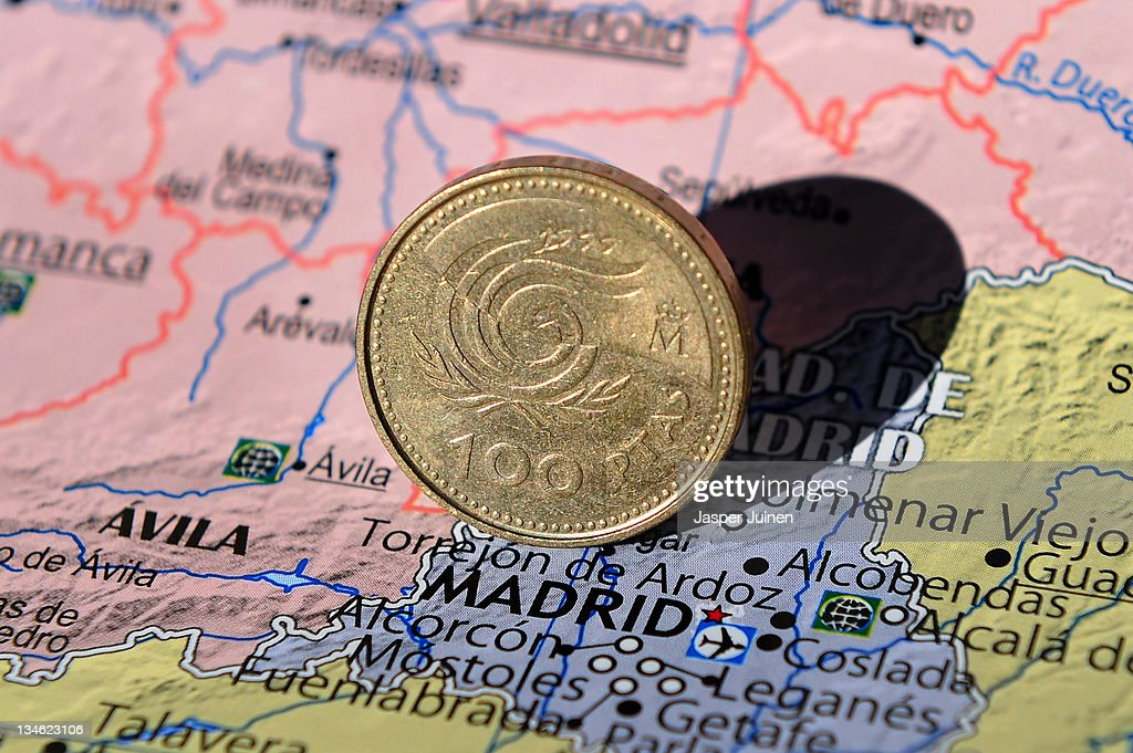 In this photo illustration a 100 Peseta coin stands on a map of Spain showing the city of Madrid on November 16, 2011 in Madrid, Spain.