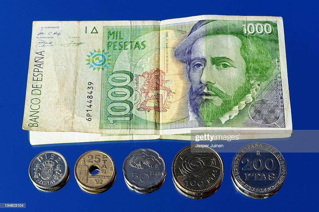 In this photo illustration a 1000 Peseta note and Peseta coins are seen on November 16, 2011 in Madrid, Spain.