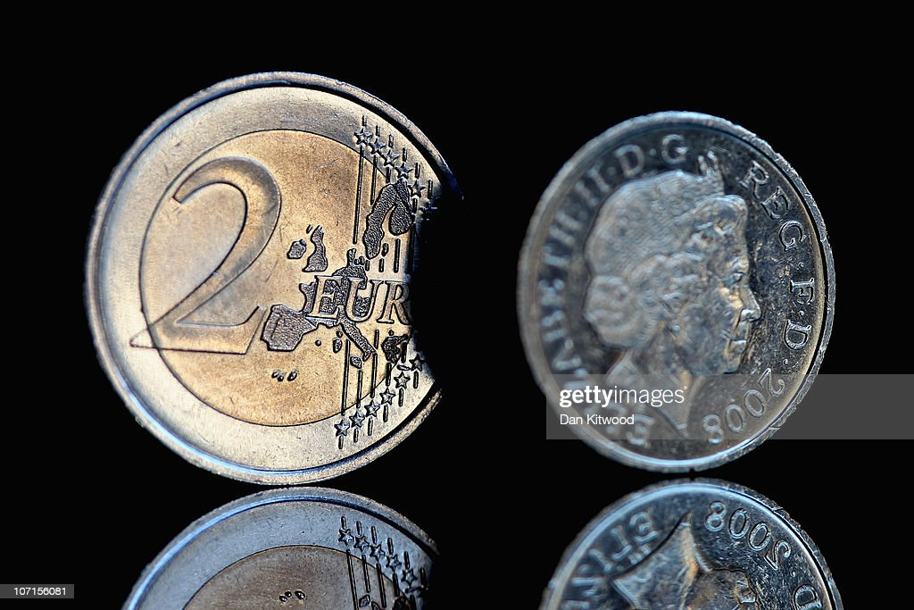 In this photo illustration a 2 Euro coin and a GBP1 coin are displayed on on November 26 2010 in London England Concerns over the Euro zone debts...