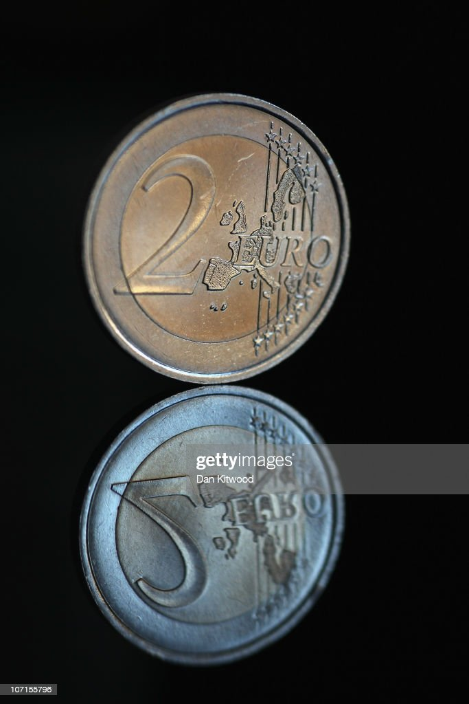 In this photo illustration a 2 Euro coin is displayed on November 26 2010 in London England Concerns over the Euro zone debts have caused shares to...
