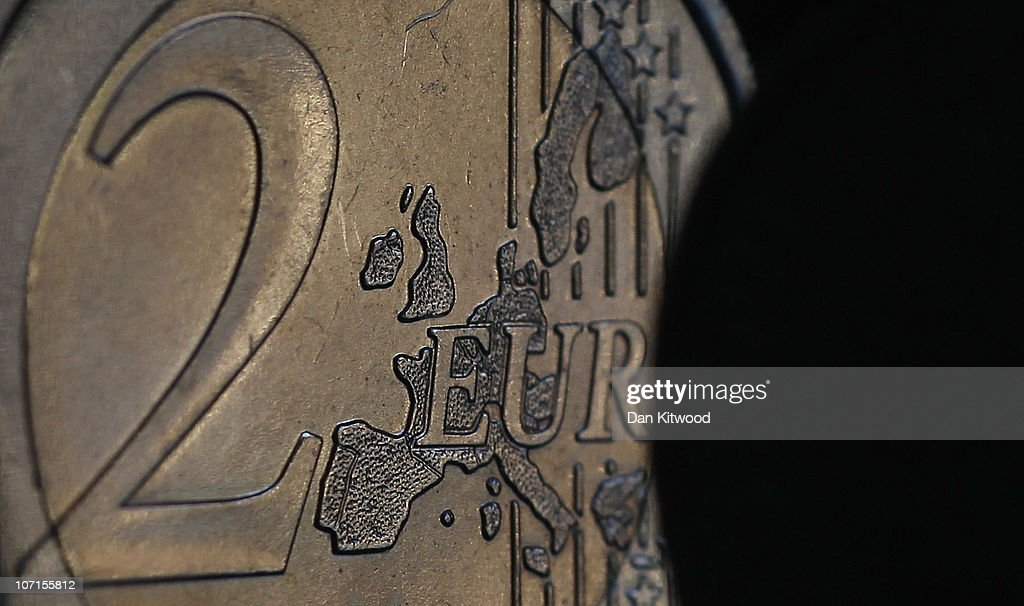 In this photo illustration a 2 Euro coin is eclipsed by a GBP1 coin on November 26 2010 in London England Concerns over the Euro zone debts have...