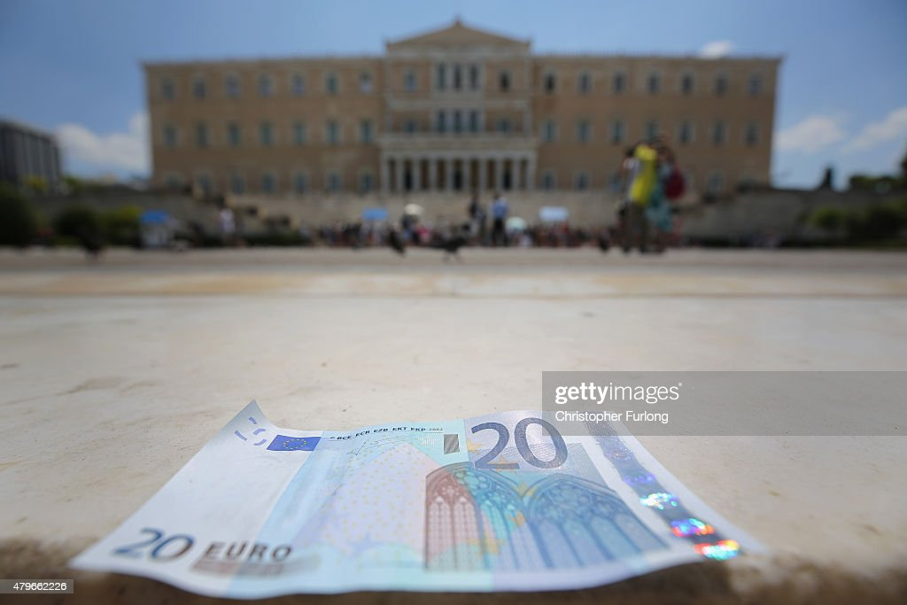 In this photo illustration a 20 Euro note sits on the steps of the Greek Parliament on July 6 2015 in Athens Greece Politicians in Europe and Greece...