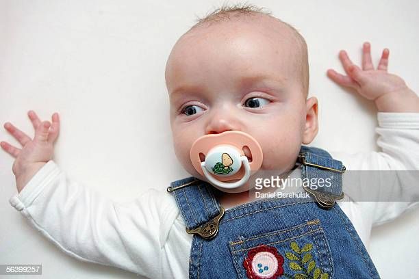 In this photo illustration a baby suckles a dummy whilst resting in her cot on December 09 2005 in London England A recent US study has shown that...