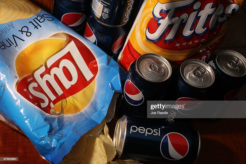 In this photo illustration a bag of chips maufactured by PepsiCo's Frito-Lay brand and cans of their Pepsi soda is seen on March 22, 2010 in Miami, Florida. PepsiCo announced plans to cut sugar, fat, and sodium in its products to address health and nutrition concerns. The maker of soft drinks including Pepsi-Cola, Gatorade also makes Frito-Lay brand snacks.