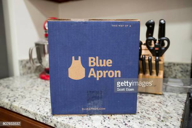 In this photo illustration a Blue Apron box waits to be opened on a kitchen counter on June 28 2017 in Boston Massachusetts The online mealkit...