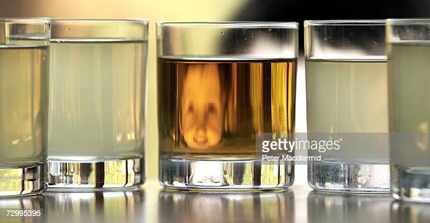 In this photo illustration a boy looks at a glass of clear and cloudy apple juice on January 14 2007 in London A Society of Chemical Industry report...