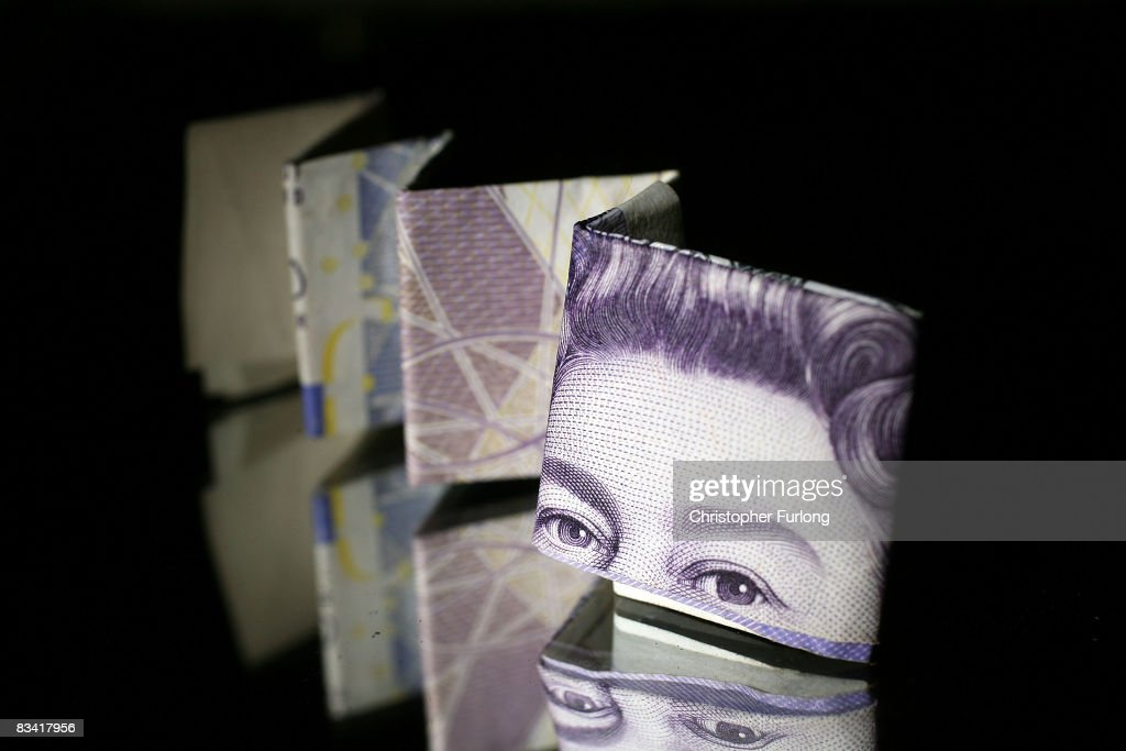 In this photo illustration a British 20 pound note is reflected in glass on October 23, 2008 in Manchester, England. As markets across the globe continue to struggle the world wide credit crunch begins to bite deeper with fears of economic recession