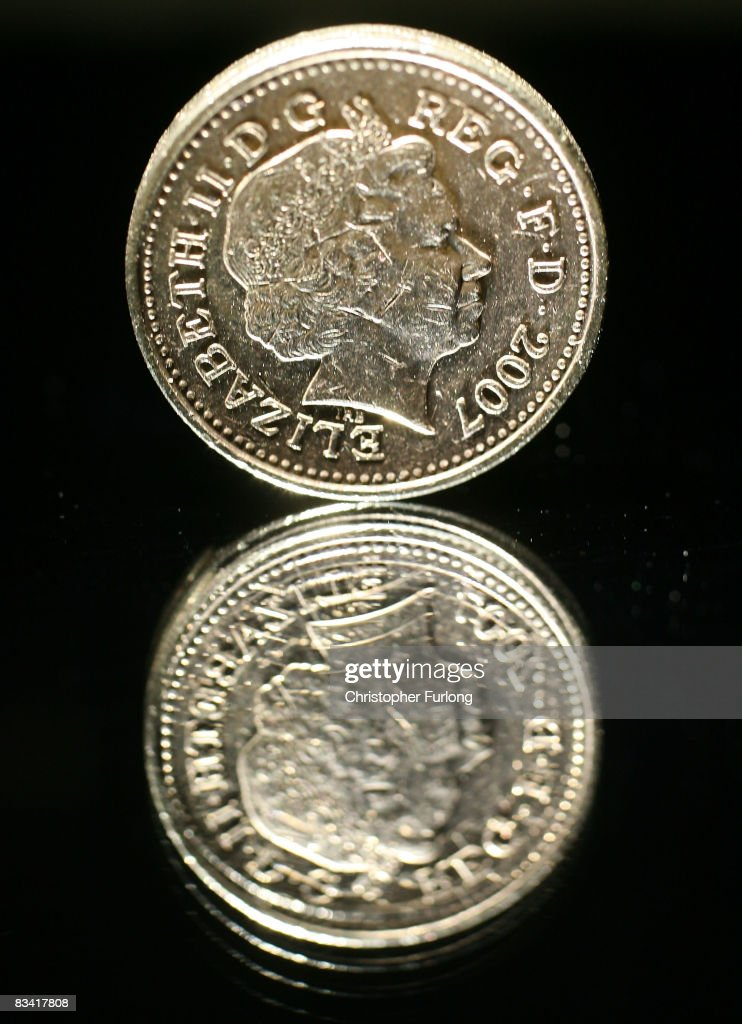 In this photo illustration a British pound coin is reflected in glass on October 24, 2008 in Manchester, England. As markets across the globe continue to struggle the world wide credit crunch begins to bite deeper with fears of economic recession