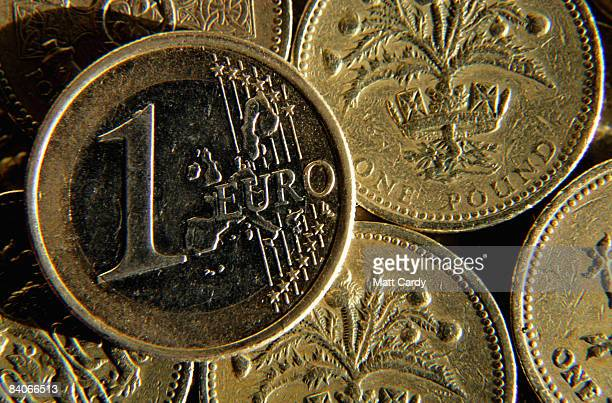 In this photo illustration a British Pound coins are seen below a Euro coin on December 17 2008 in Bristol England The British Pound is currently at...