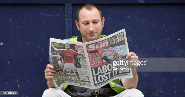 In this photo illustration a builder reads a copy of The Sun newspaper on September 30 2009 in London England The Sun today led with the headline...