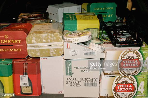 In this photo illustration a car boot filled with wine beer and cheese waits at the Calais ferry port to return to Dover on November 13 2006 in...