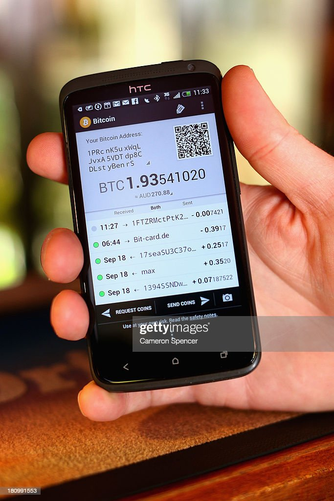 In this photo illustration, a customer pays for drinks at the Old Fitzroy Pub using bitcoins on September 19, 2013 in Sydney, Australia. The Old Fitzroy pub in Sydney's eastern suburbs will accept the digital currency, Bitcoin, as of Next Sunday. Using a smartphone and a QR code scanning application customers will be able to purchase beer and menu items at the bar. The Old Fitzroy is the first Australian pub to accept Bitcoin payment.