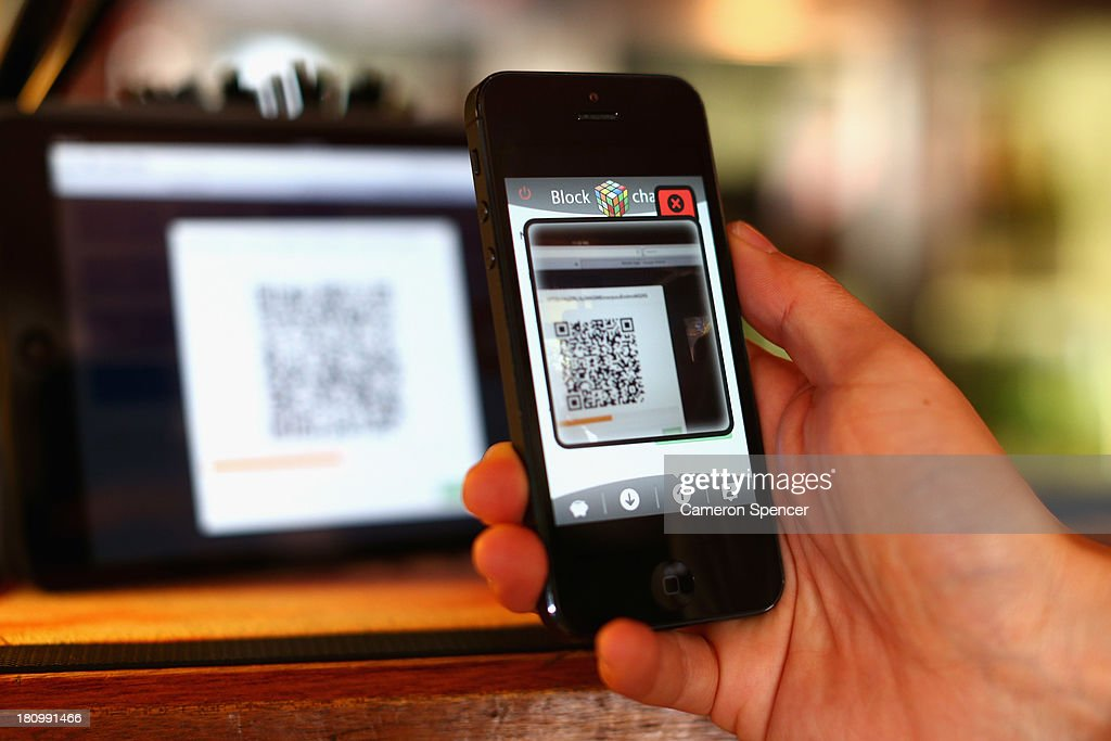 In this photo illustration, a customer scans a QR code to pay for drinks using bitcoins on September 19, 2013 in Sydney, Australia. The Old Fitzroy pub in Sydney's eastern suburbs will accept the digital currency, Bitcoin, as of Next Sunday. Using a smartphone and a QR code scanning application customers will be able to purchase beer and menu items at the bar. The Old Fitzroy is the first Australian pub to accept Bitcoin payment.