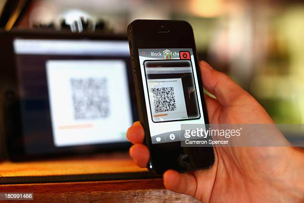 In this photo illustration a customer scans a QR code to pay for drinks using bitcoins on September 19 2013 in Sydney Australia The Old Fitzroy pub...
