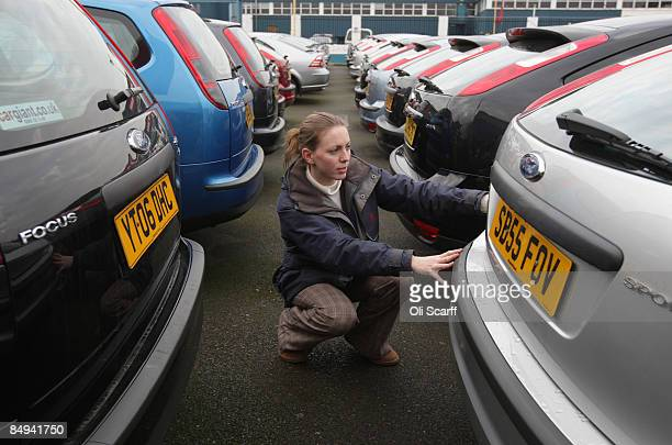 In this photo illustration a customer views the cars on sale at Cargiant the world's largest car supermarket in White City on February 19 2009 in...
