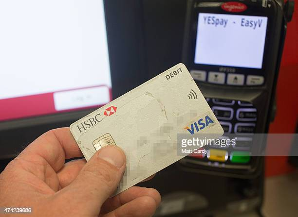 In this photo illustration a debit card is seen being used in a chip and pin machine on May 21 2015 in Bristol England Cashless payments have...